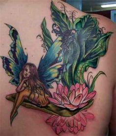 Fairy Tattoo # 78 - Anyone can't resist him/her self from admiring this fantastic fairy tattoo design. Floral and fairy always rock together. Pin & like if you agree:)