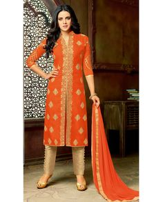 Orange colored art silk front slit top paired with beige colored shantoon bottom. This suit is embroidered with zari and stone work all over the top. It comes with a matching chiffon dupatta. This suit can be stitched upto bust size 42 inches