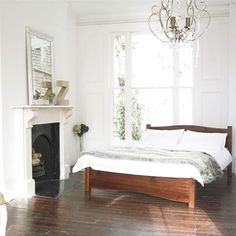 Chandelier, white paint, wooden bed, fireplace, bedroom design ideas