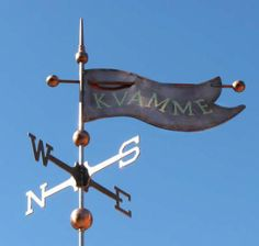 Decorative Banner Weather Vane #5  by West Coast Weather Vanes.  This handcrafted decorative banner  comes with the custom spun copper finial above and hand spun copper globes to the right and left of the banner.