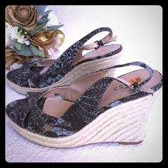 NWOT GUESS WEDGES Great floral pattern on these wedges. Never worn. I bit of shoe clue on inner strap of left shoe. Guess Shoes Wedges