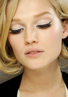 liquid liner and dramatic mascara. bright white shadow with subtle brown crease to make eyes pop.