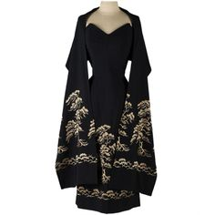 Vintage 1950's Black Embroidered Dress with Wrap | From a collection of rare vintage evening dresses at http://www.1stdibs.com/fashion/clothing/evening-dresses/