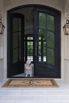 Check out this elegant entry with arched double doors and a monogrammed doormat on HGTV.com.
