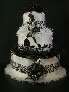 3 Tier ZEBRA DIAPER CAKE baby shower centerpiece baby shower ideas baby shower gifts black and white diaper cake gender neutral diaper cake. $49.99, via Etsy.