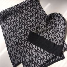 Michael Kors scarf & hat set Reversible dark & light gray Michael Kors scarf in perfect condition. Worn once Michael Kors Accessories Scarves & Wraps
