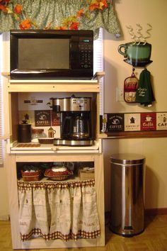I live in a single wide mobile home and am very limited for space. I asked my hubby if he could make me a coffee nook.  We had so much fun putting this decor together after he built it. I love it. The drawer slides out.