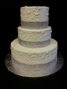 This cake (2 tier) without the silver studs. Instead we are having dark teal shell buttercream piping