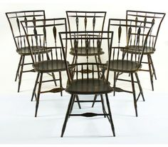 A marriage of folk art & fine Windsor chair-making can be found in this set of chairs. While certain design elements indicate Pennsylvania, such as the half-spindle back of the lower register, more characteristics point to New England, most likely Maine. These include the birdcage crest, leaf & flower decoration, &  fine turnings. The arrow shape of the center register of spindles gives each chair a lot of punch, especially when added to the generous thumb-back lean of the uprights…