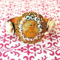 http://www.etsy.com/listing/72475724/swarovski-crystal-barbie-hinged-cuff?ref=v1_other_1