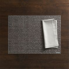 Shop Chilewich ® Gilt Gunmetal Vinyl Placemat and Fete Dove Cotton Napkin.  A loose weave creates a uniquely textured placemat that you'll only find at Crate and Barrel.