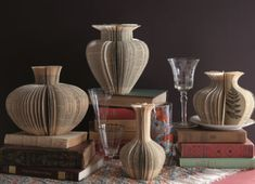 Paper Vases Made From Old Books Beautiful paper vases made from repurposed books. The Repurposed Library by Lisa Occhipinti contains 33 projects to make art from old books. Folded Book Art, Paper Book, Book Folding, Paper Folding, Old Book Crafts, Book Page Crafts, Table Origami, Fun Crafts, Paper Crafts