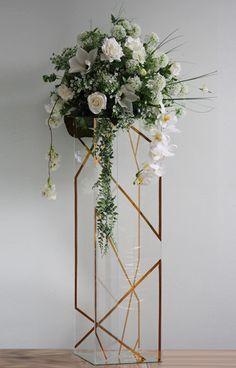 Spring's Breath centrepieces with more white flowers added and on stand with gold elements added  http://partydesign.com.au/centerpieces/index.htm