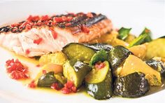 Beautifully braised, slow cooked courgettes and delicate flakey salmon make up   this wonderful and healthy summer dish