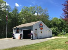 Beautiful day at the Garage Mahal. Shelby and John Deere well represented in there Home Workshop, Garage Workshop, Cool Garages, Old Garage, Men Cave, Old Gas Stations, Ford Shelby, Gas Pumps, Garage Shop