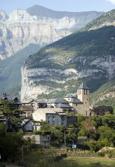 Tucked amid the highest peaks of the Pyrenees, the tiny village of Torla (Spain), having less than 200 inhabitants, is lost in time. Be immersed in the Spain of old, sampling the local specialties of jamon and queso viejo. The stone buildings, most built before 1600, small cobblestone streets and untouched charm of this former farming town has been plucked from a storybook.