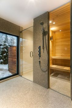 The renovated house is outfitted with a sauna. Tagged: Bath Room and Enclosed Shower. Photo 9 of 10 in 10 Sterling Saunas in Modern Homes from Near Montreal, a House Gets a Modern Makeover. Browse inspirational photos of modern bathrooms. Saunas, Indoor Sauna, Sauna Design, 1950s House, Luxury Shower, Spa Rooms, Shower Panels, Shower Systems, Walk In Shower