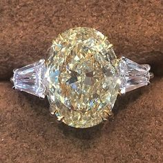 Lovely 4.0 carat fancy yellow oval engagement ring. Available at Alson Jewelers. Call 216-464-6767 for more information. www.alsonjewelers.com