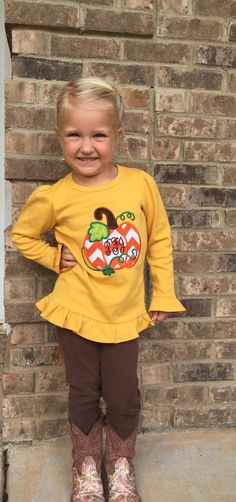 A personal favorite from my Etsy shop https://www.etsy.com/listing/251368049/long-sleeve-pumpkin-applique-with