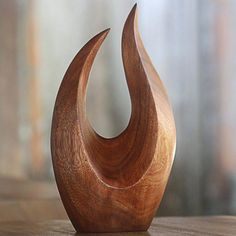 Bloomsbury Market Flames of fire dance in this wood sculpture from Eka of Indonesia. The expertly hand-carved sculpture is enhanced by the striking grain of the suar wood making the minimalist design an exquisite centerpiece in any home or office. Wood Carving Art, Stone Carving, Abstract Sculpture, Wood Sculpture, Metal Sculptures, Sculpture Ideas, Buy Wood, Wood Wood, Wood Turning Projects