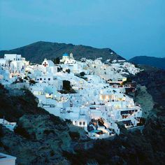 The night just seems better in the cliff-top village of Oia, #Greece.