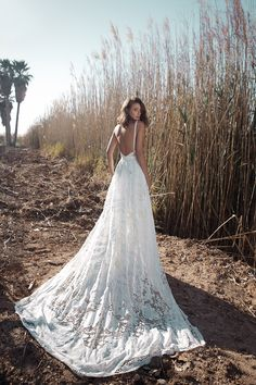 Dalphin back from Flora wedding dresses 2018 - Deep v-open back with floral lace detailing, layered skirt with train. Shoe string lace straps.- see the rest of the collection on www.onefabday.com