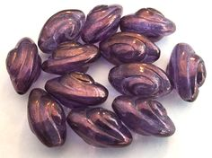 Czech beads ((8) large glass pressed purple deco style swirl ridges shell spaceship 19mm (8) by a2zDesigns on Etsy