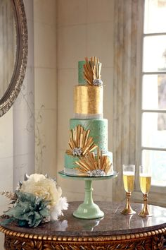 gold and teal wedding cake