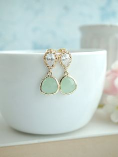 ♥´¨) ¸.•´ ¸.•*´¨) (¸.•´ ♥ ~ Gorgeous light mint gold plated frame faceted glass jewels dangle beneath from gold plated cubic zirconia ear posts. Gold plated over brass cubic zirconia ear post (925 Sterling silver post), and measure approx. 10x12mm. Size of Pear jewels measures approx. 13x15mm. Ear posts are high quality, anti tarnish treated and Hypo allergenic.  Total length of earrings is approx. 1 inch.  :: For more Bridal Collection : http://www.etsy.com/shop/Marolsha?...