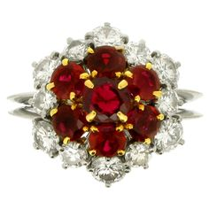 BOUCHERON Ruby, Diamond and Platinum Cluster Ring | From a unique collection of vintage cluster rings at https://www.1stdibs.com/jewelry/rings/cluster-rings/