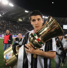 Alvaro Morata of Juventus FC celebrates with the trophy after winning the TIM Cup final match against AC Milan at Stadio Olimpico on May 21, 2016 in Rome, Italy.