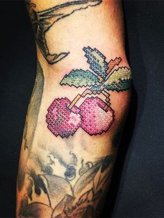 Beautiful cross-stitched tattoos by Eva Krbdk