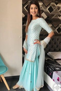 Sky blue sharara-style suit paired with Luminous Gold Juttis Perfect for day weddings! Sharara Designs, Kurti Designs Party Wear, Designer Party Wear Dresses, Designer Kurtis, Indian Designer Suits, Indian Designer Clothes, Designer Salwar Suits, Indian Party Wear, Indian Wedding Outfits