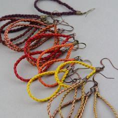 Hand-made braided leather earrings , mounted on brass guaranteed nickel free.The earrings measure between 4.5 and 6 cm without the hook.Both light and colorful, these earrings, made in very small series, will add a touch of gaiety in your winter outfits !They come with silicone ear clutches, in a gift envelope. Boucles d'oreille faites-main, en cuir tressé, montées sur laiton garanti sans nickel.Les boucles d'oreille mesurent entre 4,5 et 6 cm sans le crochet....