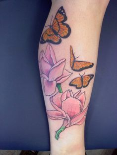 My leg tat....Memorial tat for my mom. Magnolia blooms (her favorite) and 3 Monarch Butterflies (representing my Mom, my daughter and myself). Done by Jason Dunavan- Altered Ego's Champaign, IL (now with 5 star tattoo)