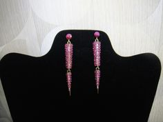 """Two tone pink spike earrings with rhinestones and gold accents. 3"""" in length"""