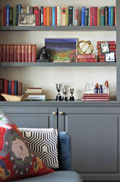 Refresh built-ins with a rich color and complementary hardware for an easy interior update. Carmel from Our Fifth House applied grasscloth wallpaper to the backs of her bookshelves for added texture. Bookcase Makeover, Bookcase Styling, Bookcase Shelves, Grey Bookshelves, Room Shelves, Large Shelves, Shelf Design, Diy Design, Design Ideas
