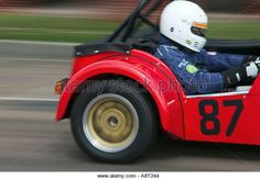 A red Caterham Super 7 racing car accelerates at Brighton Speed Trials Madeira Drive - Stock Image
