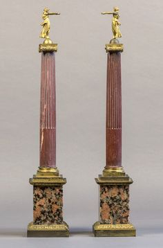 Fluted red hardstone columns on square marble base the ionic gilt