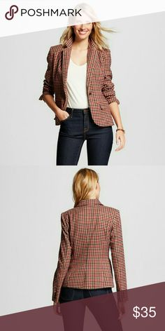 Merona Houndstooth Tailored Blazer Camel Blazer Features:  Checkered Print  Colors include,  Burgundy and mauve, Navy Blue & Tan  Pointed collar One front button closure  Front flap pocket Machine wash, cold, midweight fabric 70% Polyester, 25% Rayon, 3% Wool Merona Jackets & Coats
