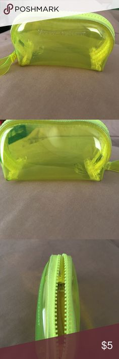 Victorias secret Cute small plastic highlighter yellow zipper pouch. Very small can fit earbuds. A small chapstick. Great to throw in a bag for small items Victoria's Secret Other