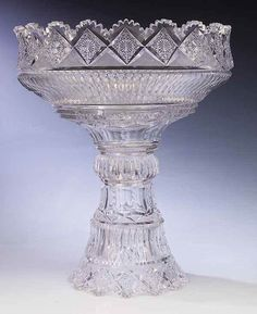 An American Brilliant Cut Glass Punch Bowl-on-Stand , c. 1900, Pitkins and Brooks, Chicago, IL, Derby pattern, marked on both bowl and base, P, elaborately patterned with deep cutting on pure lead-glass blanks, height 16 1/8in., width 13 3/4 in.,