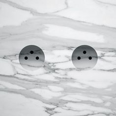 I love this minimal take on electricity sockets. The absence of the typical plastic rectangle is refreshing and modern. Love the marble look as well.