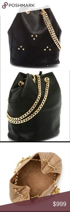 """Black Maisie Bucket Cross body Bag Black Maisie Bucket Cross body Bag Featuring an ever-trending bucket shape and eye-catching link chain shoulder strap, this standout bag finishes your ensemble in bold style. Details: - Dual adjustable chain shoulder straps - Drawstring closure - Exterior features gold-tone hardware - Approx. 9.75"""" H x 6.5"""" W x 6.75"""" D - Approx. 12"""" handle drop, 12-25"""" strap drop PU exterior, fabric lining ✅I ship same or next day ✅Bundle for discount Pink Haley Bags"""