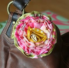 How to make this beautiful ribbon flower. I like the idea of putting some of these home made flowers on purse straps to liven them up and make you smile.