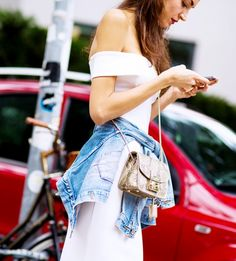 3 Totally Cool Dress Styles To Try This Weekend via @WhoWhatWear - off the shoulder dress + denim shirt