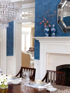 In this dining room of a Connecticut house, creamy white moldings in Farrow & Ball's Pointing are a dramatic contrast with the Prussian blue Venetian plaster walls.