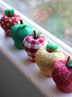 Stuffed Apple pin cushions.   Pattern by Retro Mama.  Fabric is Sunnyside Ave by Amy Smart for Penny Rose Fabrics.