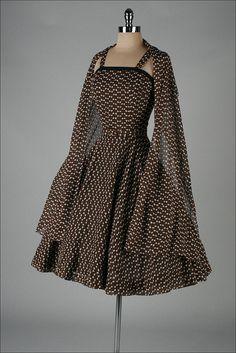 Vintage 1950's cotton sun dress, moth print  with wrap and belt