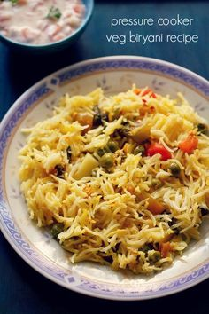 veg biryani recipe in pressure cooker - sharing an easy methodof pressure cooker veg biryani recipe with step by step photos.     is it possible to make a layered veg biryani in pressure cooker?   one which